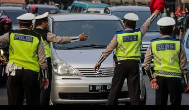 dirlantas-minta-maaf-polisi-yang-tilang-pengemudi-bawa-sepeda-dalam-mobil-disanksi
